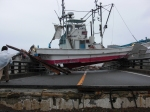 A huge fishing boat stuck on a concrete block as a result of the tsunami.
