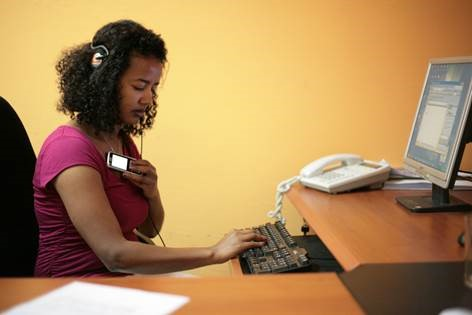 A female worker using assistive technology in the office, Ethiopia