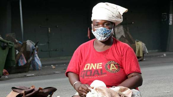 Disabled-woman-with-a-mask-Abidjan-767x431